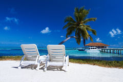 Sunbeds at the beach royalty free stock images