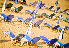 Sunbeds on the beach background Stock Photo