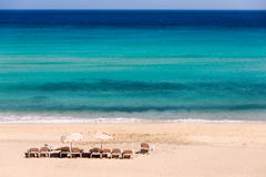 Sunbeds on the beach. Sunbeds on an empty beach in Sicily royalty free stock image
