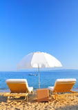 Sunbeds on beach, Greece royalty free stock photo