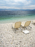 Sunbeds at beach of Kassiopi, Corfu, Greece Royalty Free Stock Image
