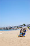 Sunbeds at the beach of luxury hotel Royalty Free Stock Image