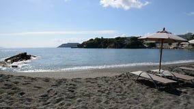 Sunbeds on the beach at luxury hotel. Crete, Greece stock video