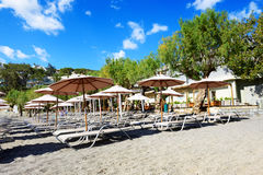The sunbeds on a beach at luxury hotel Royalty Free Stock Image