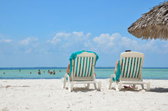 Sunbeds  on the beach near the sea. Stock Photos