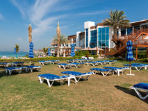 Sunbeds of beach resort in Dubai Royalty Free Stock Images