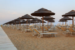 Sunbeds on the beach Royalty Free Stock Images