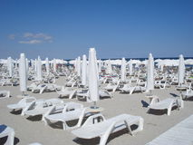Sunbeds on beach Royalty Free Stock Photo