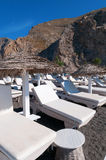Sunbeds. On the beach. Santorini island, Greece Stock Photo