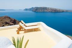 Sunbeds on the beach. Santorini island, Greece Stock Photography