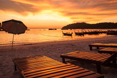 Sunbeds on the beach at sunset Stock Image