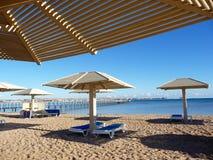 Sunbeds at the beach Royalty Free Stock Photos