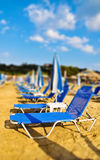 Sunbeds on the beach. Tilt shift photo Royalty Free Stock Image