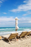Sunbeds on a beach and turquoise water Royalty Free Stock Photo