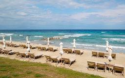 Sunbeds on a beach and turquoise water Royalty Free Stock Photography