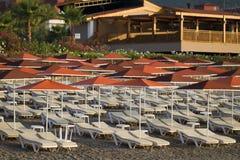 Sunbeds and beach umbrellas Stock Photos