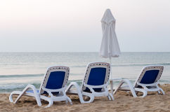 Sunbeds on the beach with a umbreluta royalty free stock image