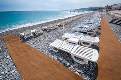 Sunbeds On Beachfront Of Nice Royalty Free Stock Image