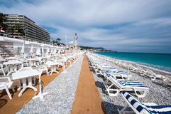 Sunbeds On Beachfront Of Nice Royalty Free Stock Images