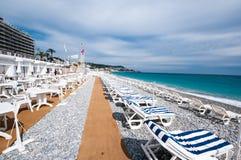 Sunbeds On Beachfront Of Nice Stock Photos
