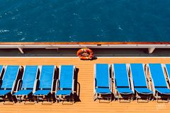 Sunbeds on boat stock images