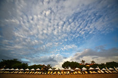 Sunbeds and clouds in the sky. Asia beach with clouds in the sky and sunbeds stock photo