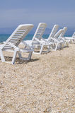 Sunbeds on the deserted beach Stock Photos