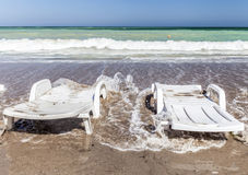 Sunbeds on a empty beach at the end of the season Royalty Free Stock Images