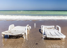 Sunbeds on a empty beach at the end of the summer Royalty Free Stock Photo