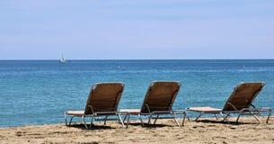 Sunbeds on an empty beach Royalty Free Stock Photo