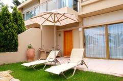 Sunbeds at entrance of luxury villa Stock Photos