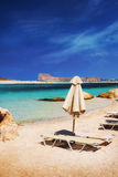Sunbeds in the exotic Balos lagoon, Crete island Royalty Free Stock Photos