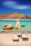 Sunbeds in the exotic Balos lagoon, Crete island Stock Photos