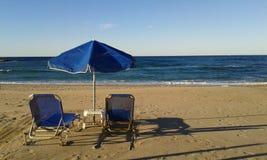 Sunbeds Fodele Beach. Sunbeds and umbrella parasol on Fodele Beach. Crete. Greece Stock Image