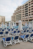 Sunbeds, hotel, pool, umbrellas Royalty Free Stock Photo