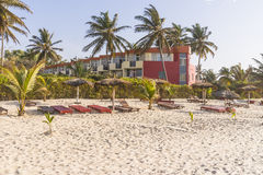 Sunbeds and hotel. Sunbeds on the tropical beach on the Atlantic Ocean. Hotel in Gambia . Africa royalty free stock photos
