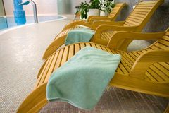 Sunbeds In The Fitness With Turquoise Towel Royalty Free Stock Photo