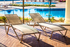 Sunbeds in the indoor swimming pool Stock Images