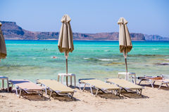 Sunbeds on beach Royalty Free Stock Photography