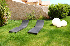 Sunbeds on lawn by luxury villa. Pieria, Greece stock images