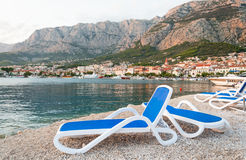 Sunbeds in Makarska beach Royalty Free Stock Photos