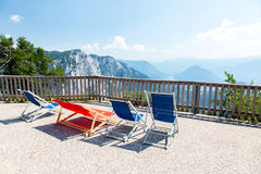 Sunbeds in mountains Stock Image