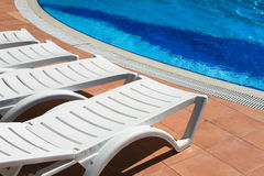 Sunbeds near the pool Stock Photo
