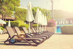 Sunbeds near a pool Stock Photo