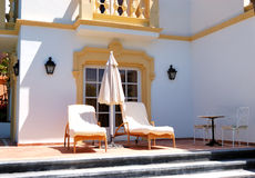 Sunbeds at the outdoor of luxury villa Stock Images
