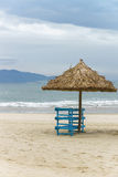 Sunbeds and Palm shelter in China Beach in Da Nang Stock Photography