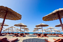 Sunbeds and parasols on the beach Royalty Free Stock Photo