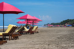 Sunbeds and parasols on the beach. Royalty Free Stock Photos