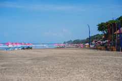 Sunbeds and parasols on the beach. Royalty Free Stock Photography