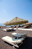 Sunbeds in Perissa, Santorini, Greece Royalty Free Stock Photos